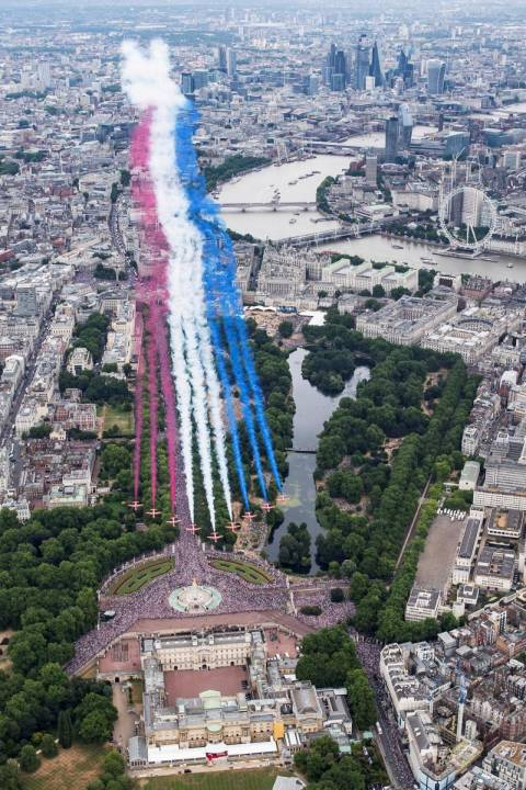 The Red Arrows over the Mall and Buckingham Palace as part of the RAF 100 flypast