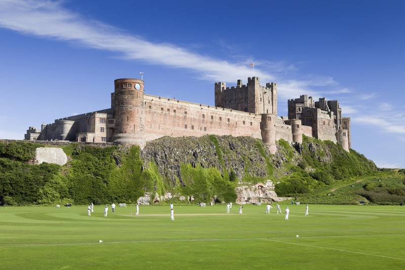 Playing Cricket below Bamburgh Castle, Northumberland
