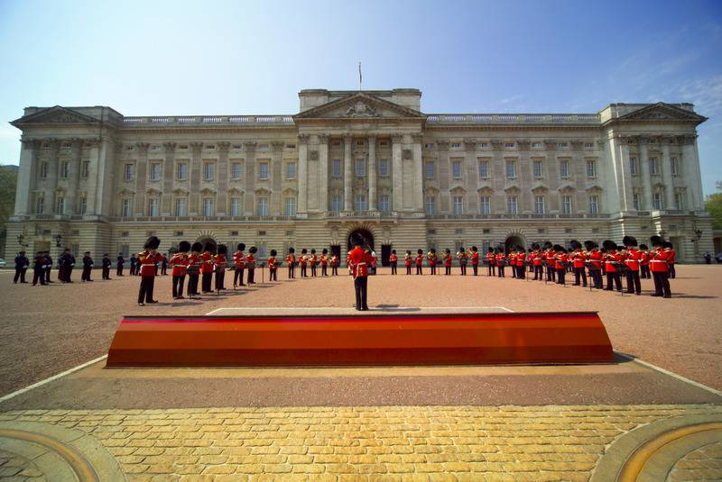 Band performing during The Changing of the Guard ceremony taking place in the courtyard of Buckingham Palace, Westminster, London